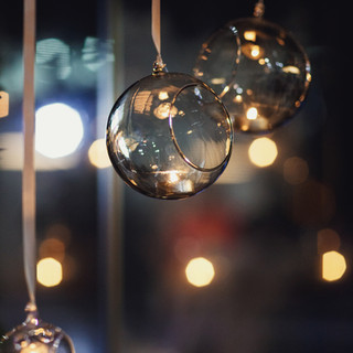 glass-balls-with-candles-hang-before-win