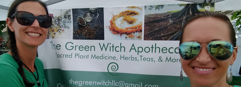 Us and Green Witch sign