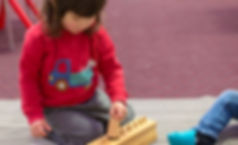 Toddler play with Montessori materials with parent