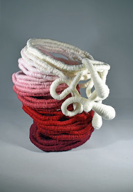 Coiled vessel of Hopewith mixed yarns and fabrics using coiling technique