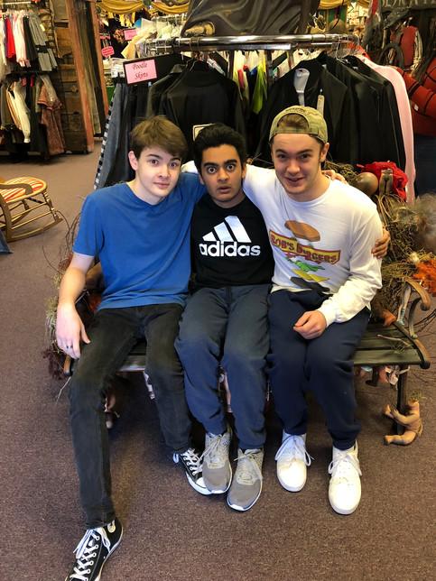 3 boys on a bench