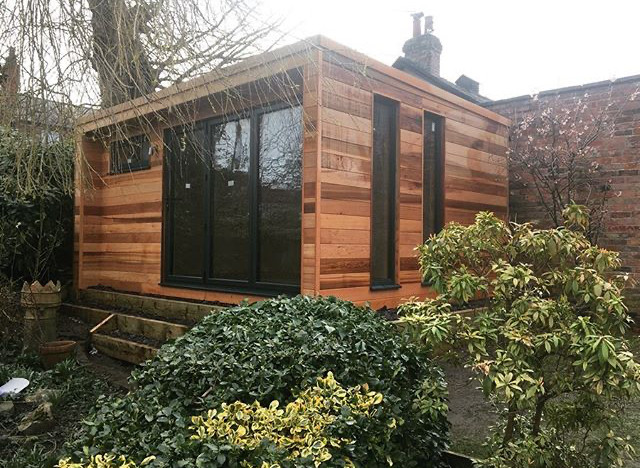 Sound studio, built using structurally insulated panels, acoustically insulated, aluminium double glazing and bifolds and cedar cladding.