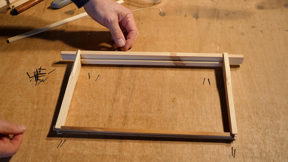 Nailing a frame with pins