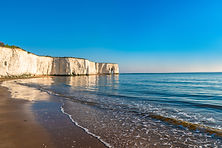 View of white chalk cliffs and beach in