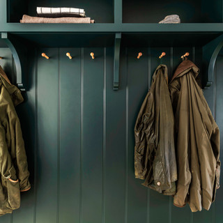 green paneling with oak pegs