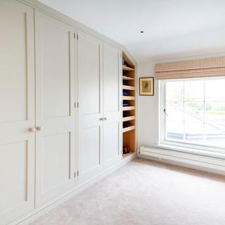 Bespoke white dressing room with oak int