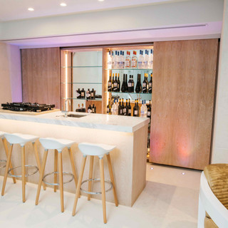 Bespoke Fitted Bar with Oak and Mirror