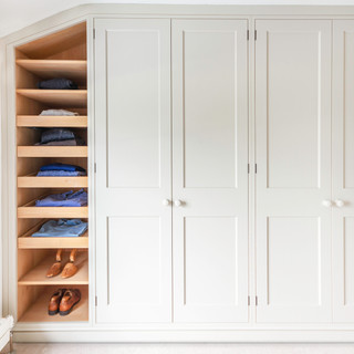Fitted wardrobes with oak shelving