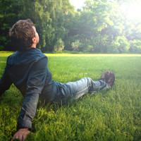 Man sitting in field.jpg