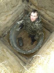 Установка колец в укрепленную шахту