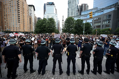 NYPD holding off protesters.webp
