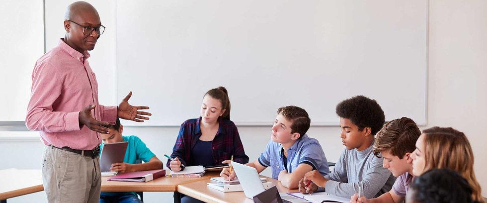 high-school-teacher-talking-to-pupils-us