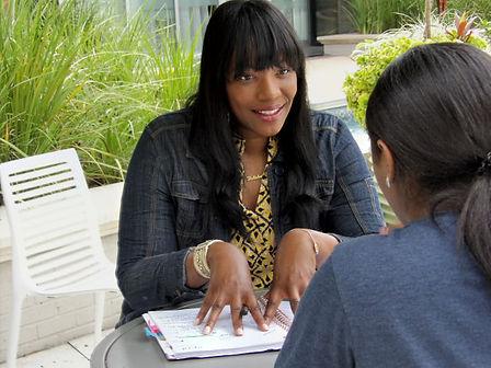 Latisha talking to Tabitha fingers on th