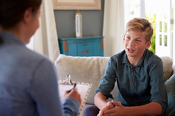Yonger child taking therapy from Psychologist
