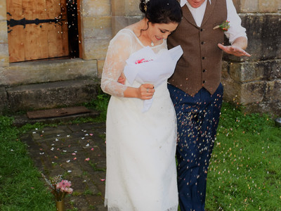 Happy Couple being rained with Eco Leaf Confetti