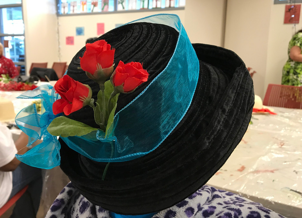 Photo, Close up of Hipolita's hat, decorated during the first Café para Dos in Hunting Park.