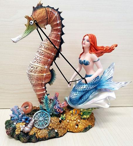 Mermaid riding a seahorse figurine