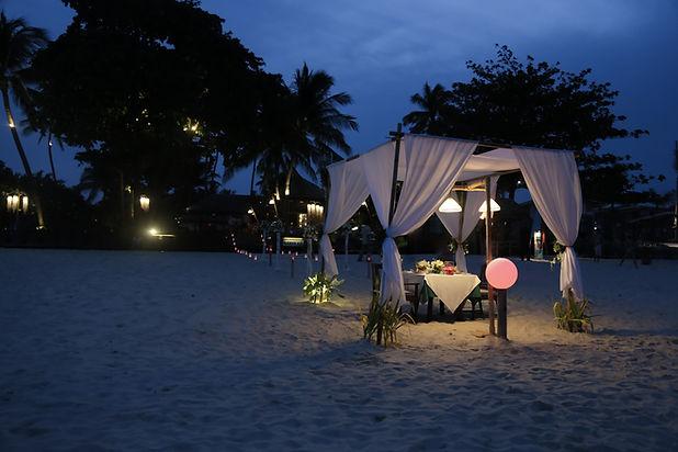 Romantic dinner setup at the beach.jpg