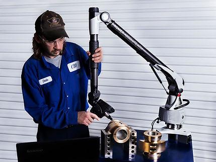 Worker etching a babbitt bearing
