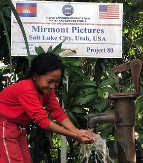 Cambodian child cleaning hands in clean water well installed by Vision Cambodian and donated by Mirmont Pictures.