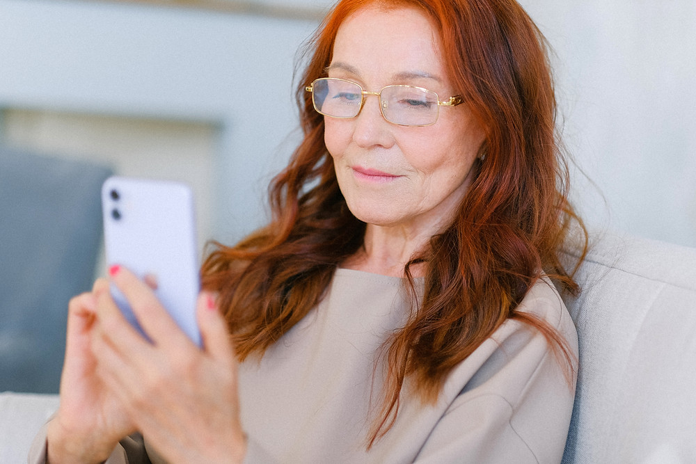 Older woman using her cell phone