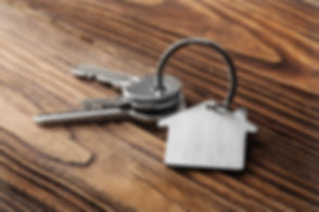 House key on  house shaped keychain  on