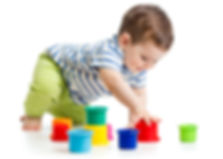 bigstock-Toddler-Boy-Playing-With-Cup-T-