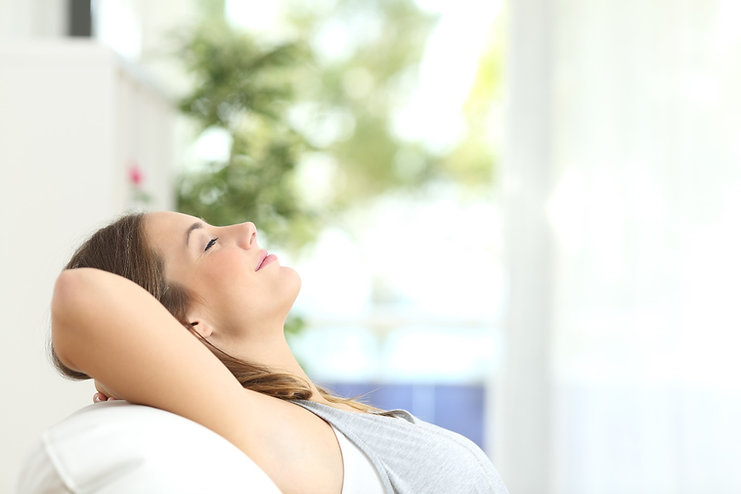 Woman Relaxing Lying On A Couch At Home_