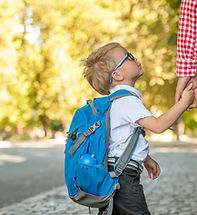 Parent taking child to school. Pupil of