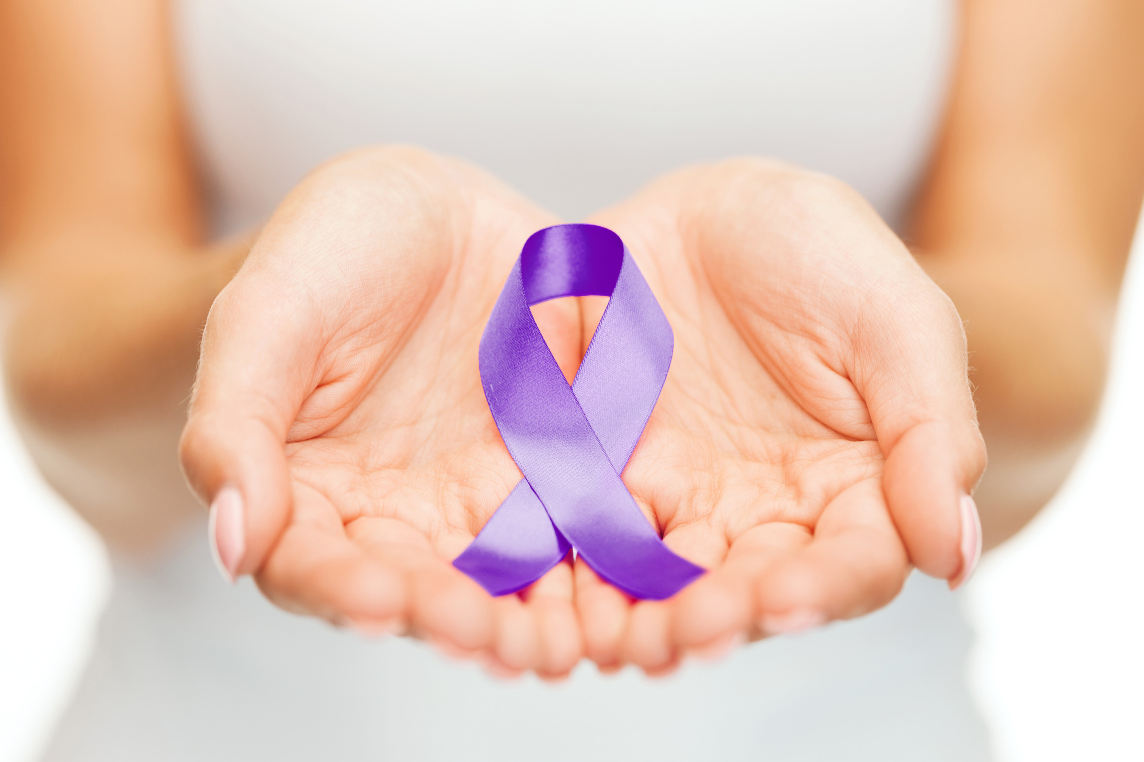 Fotosearch purple ribbon hands
