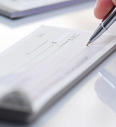 Business man prepare writing a check.jpg