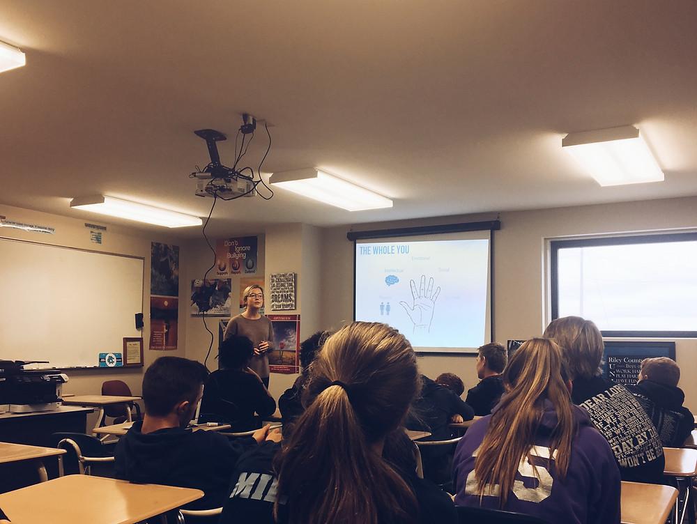 Meghan (below) educating a 9th grade classroom