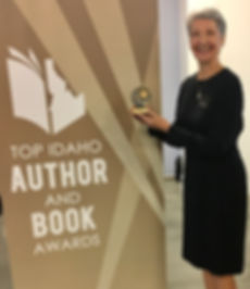 Author, Laurie Buchanan, receiving Top Idaho Author and Book Award