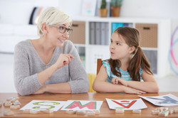 child-studying-alphabet-with-speech-therapist