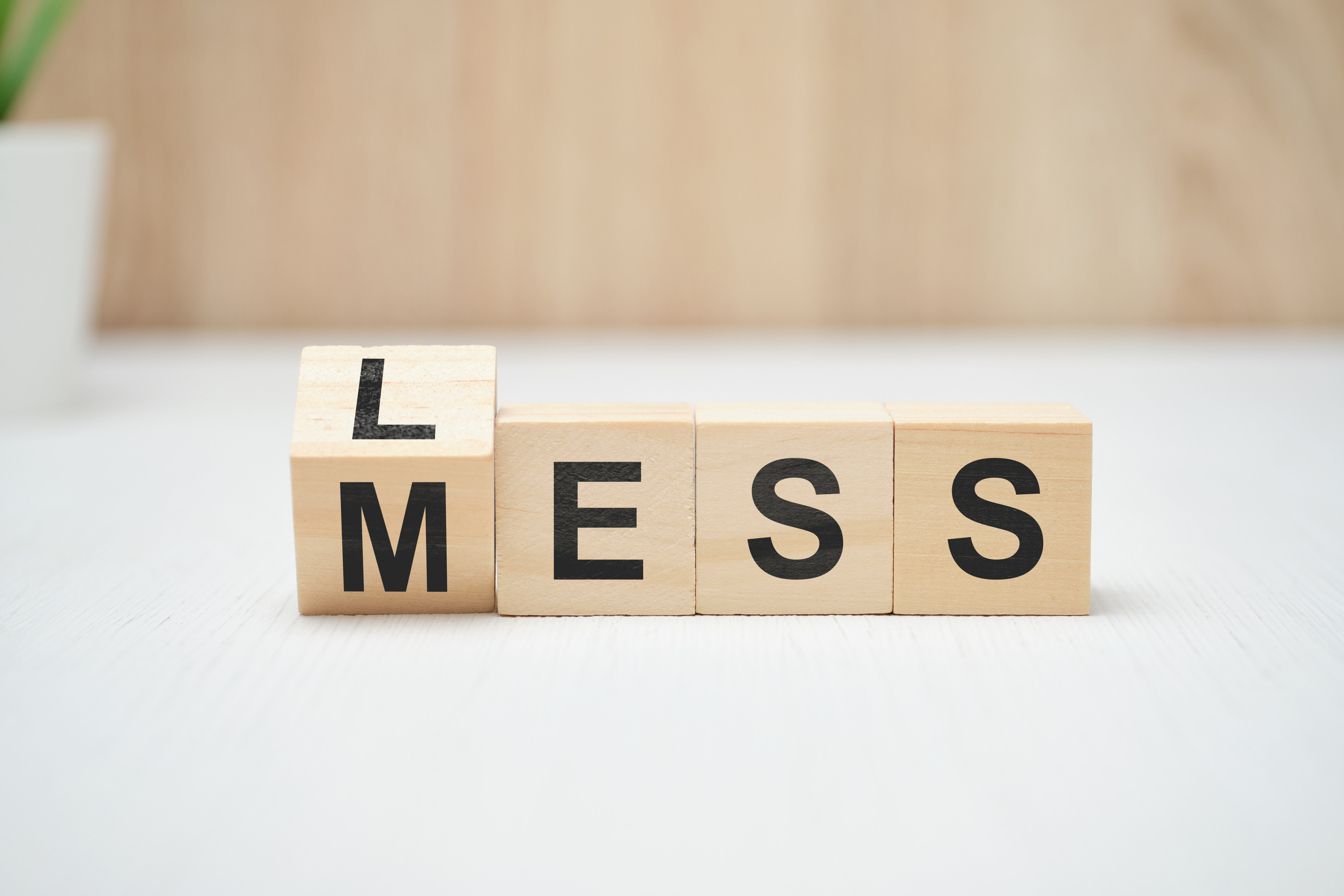 Less mess words on wooden blocks. Close