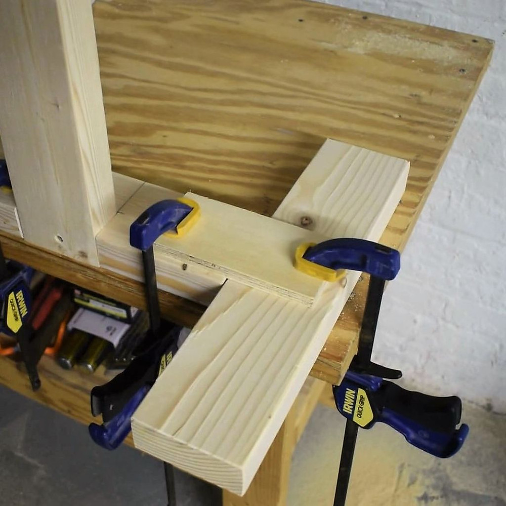 Attach the feet to the legs using plywood brackets