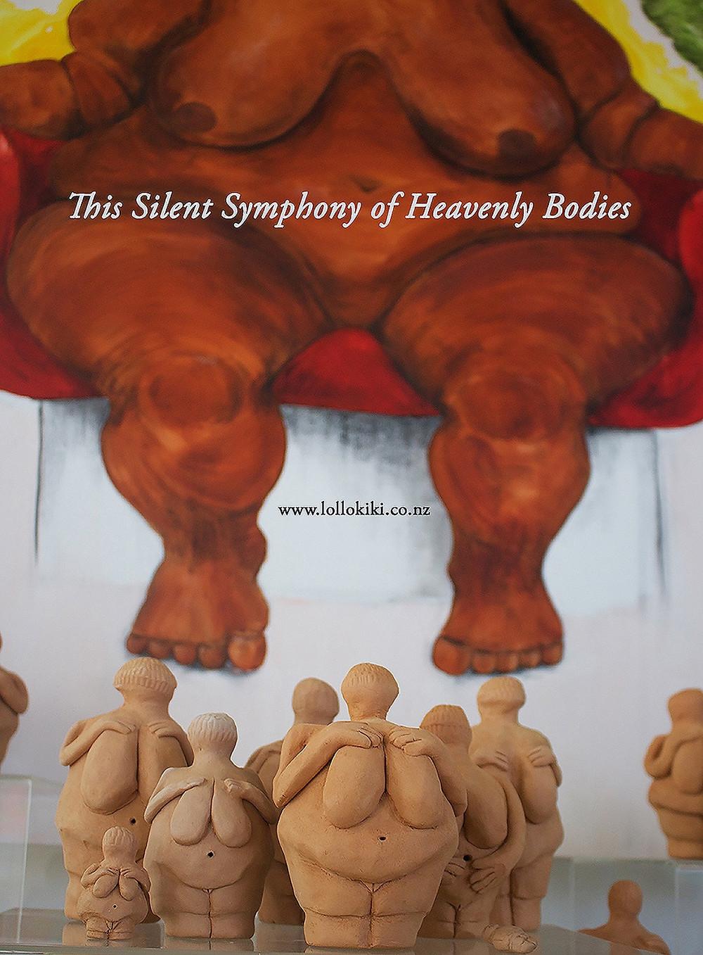 venus de willendorf sculptures infront of large canvas