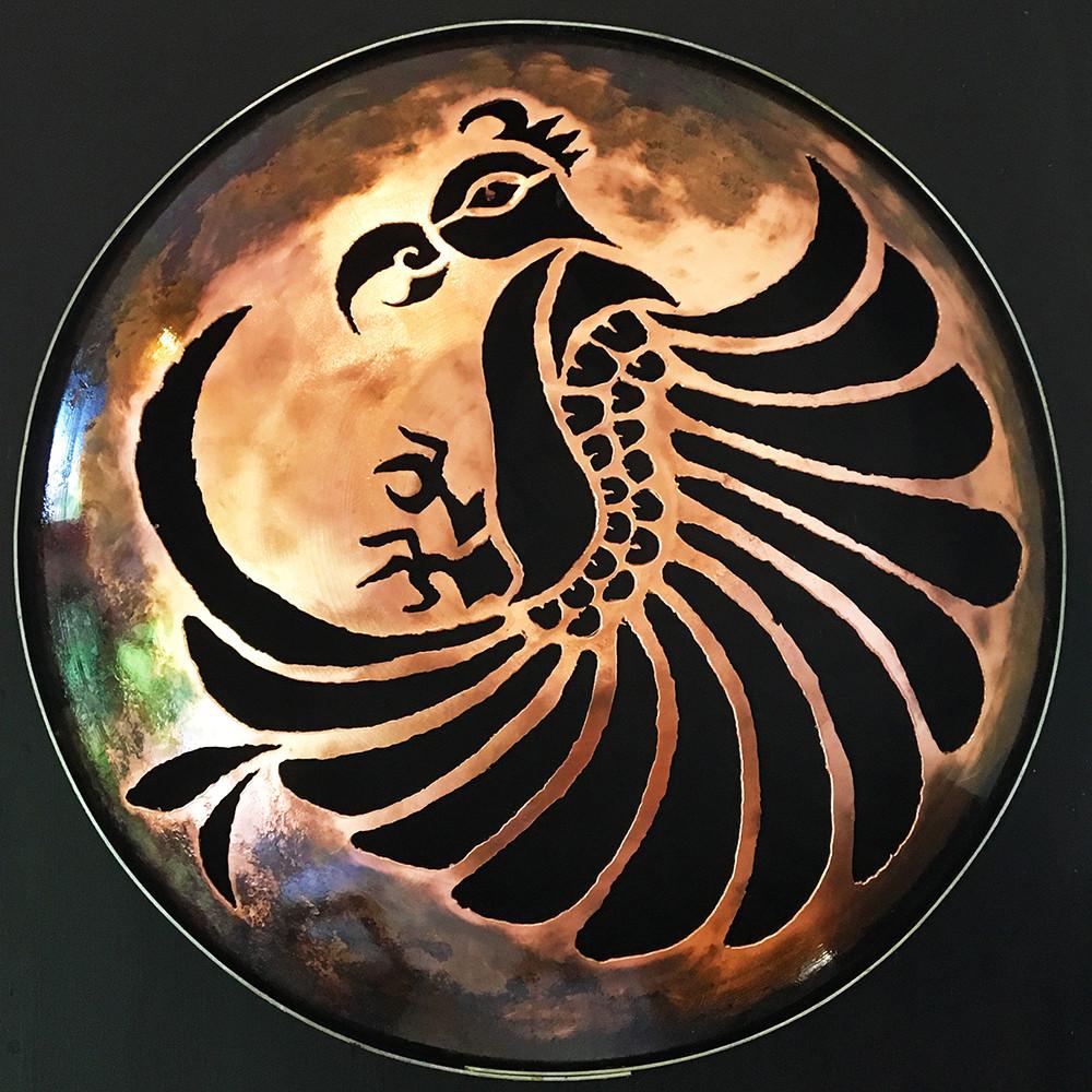 bird (manu) cut out of copper round