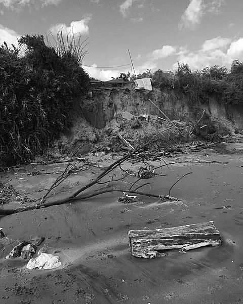 black & white image of storm ridden beach