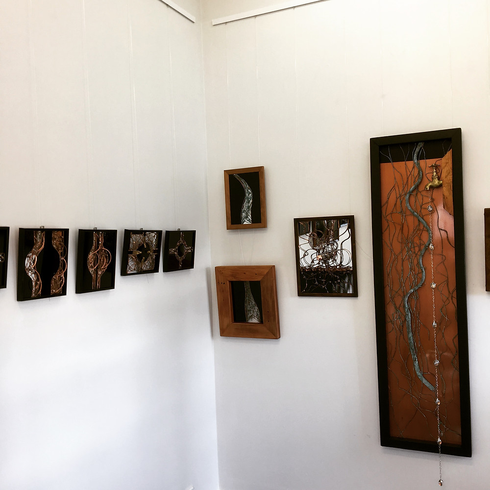 mixed media hangs on gallery wall
