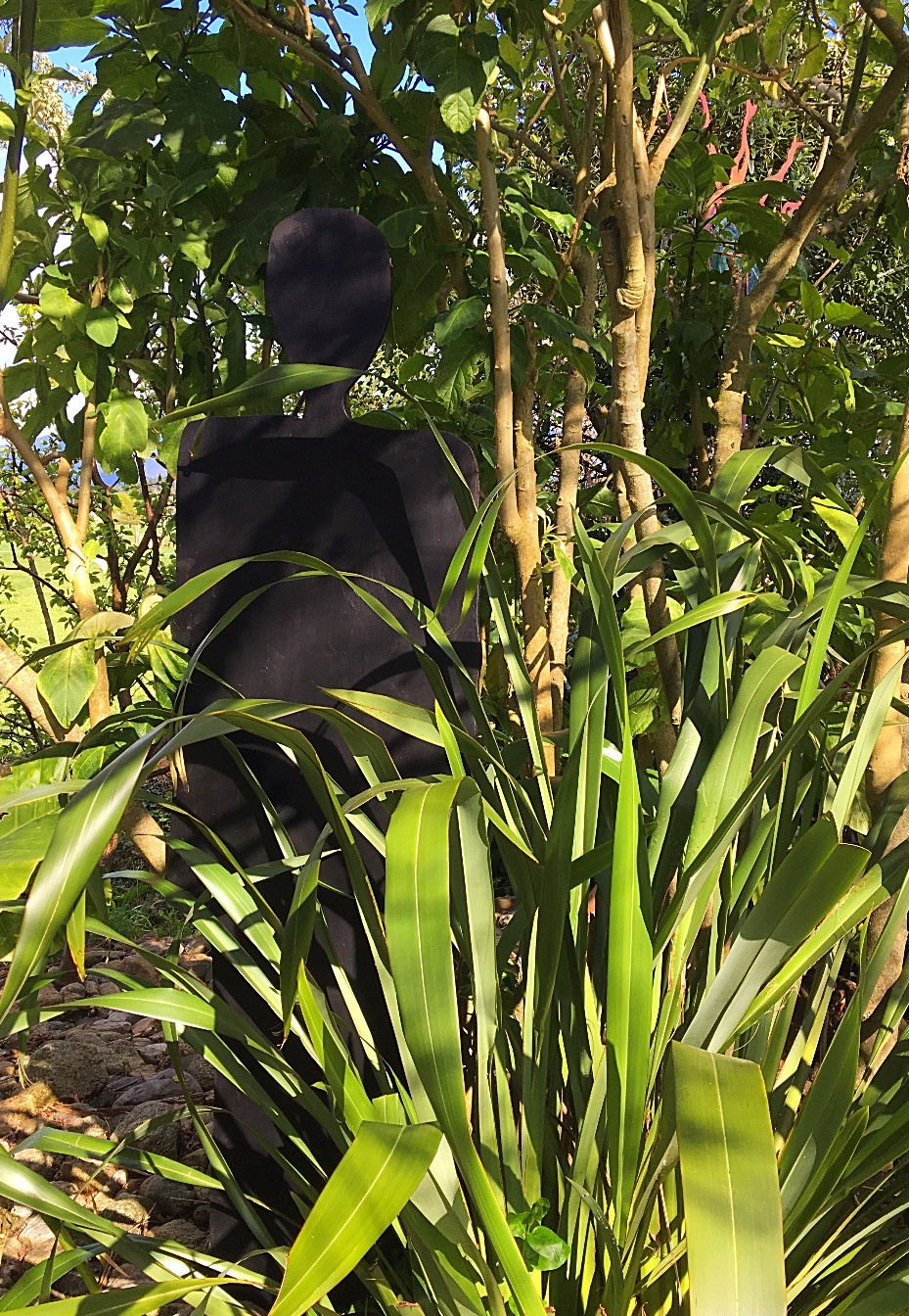 shadow figure amongst foliage