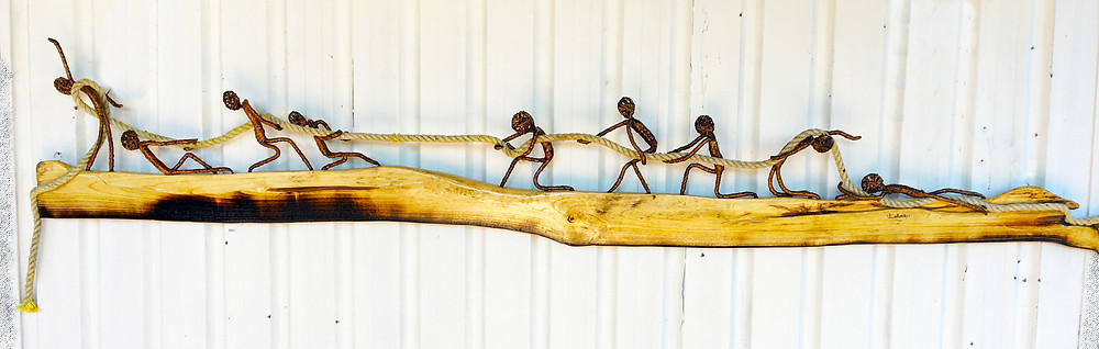 figures having a tug of war pulling a rope from both ends