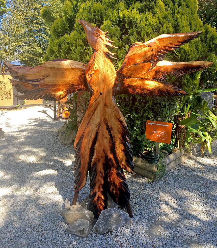 burnt wooden phoenix