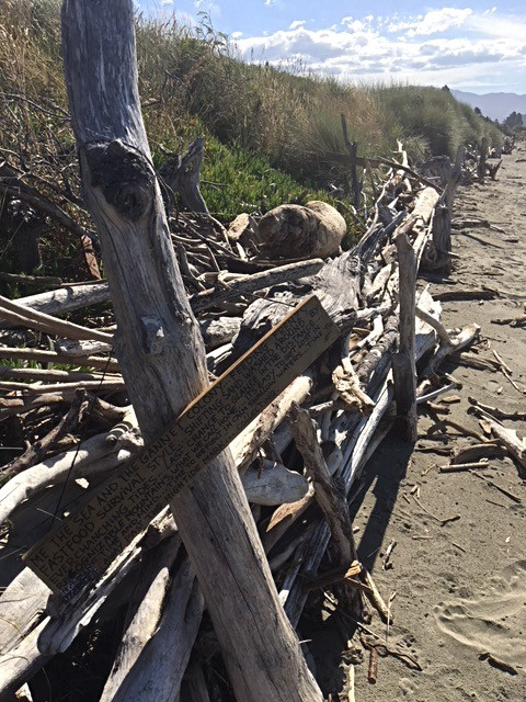 drift wood sea barrier with a poem written on wood