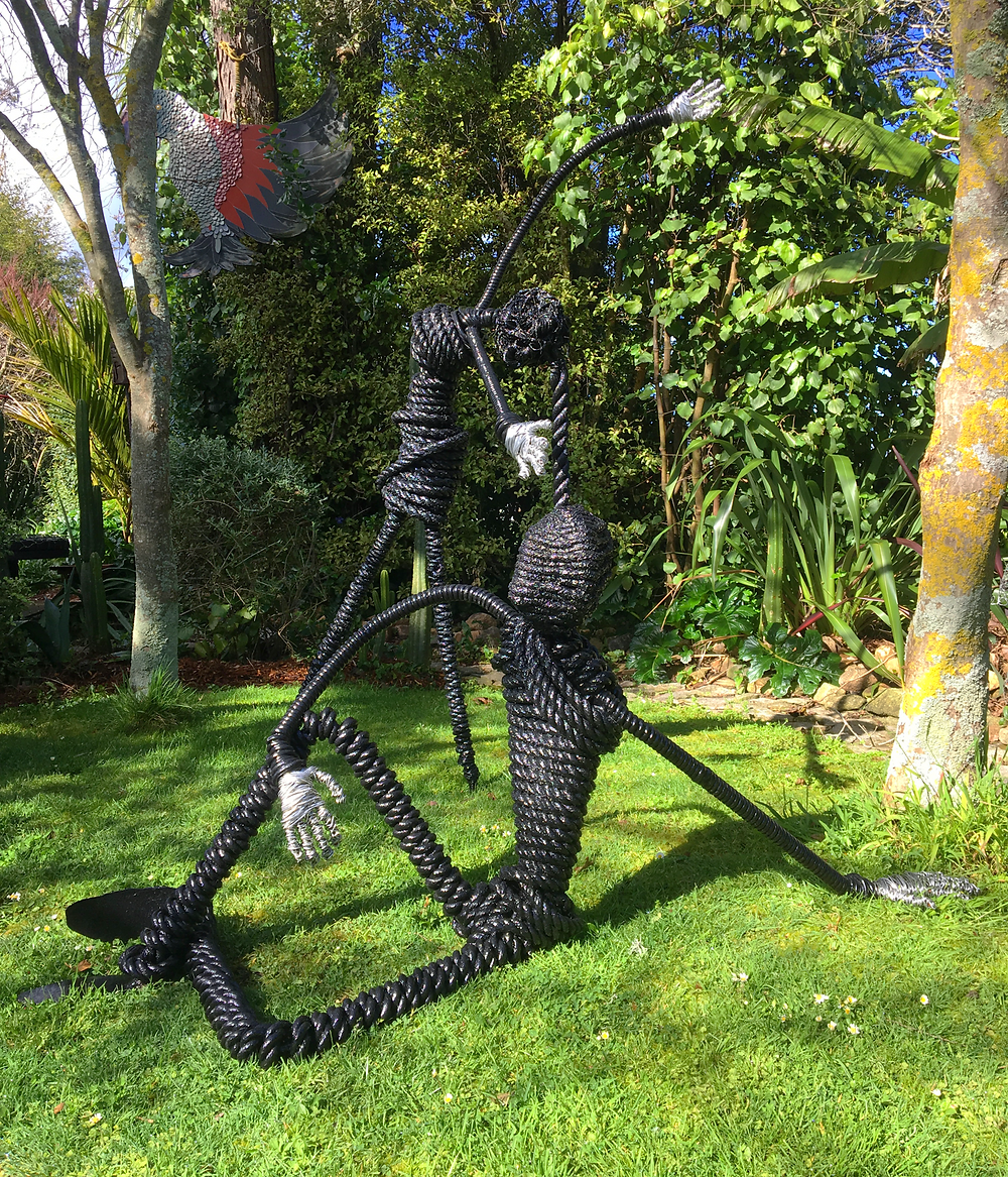 2 lifesize figure sculptures of metal and rope