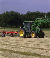 Artesian Ranch - Tractor Raking Hay