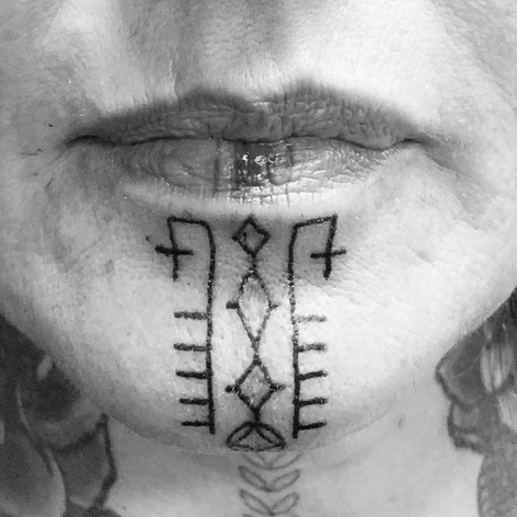 Chin Tattoo