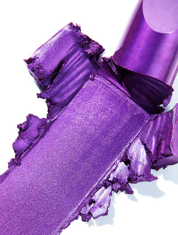 macro close up of a shimmering purple lipstick texture as it has been smeared By Ian Oliver Walsh Still Life Photographer London