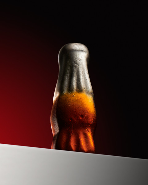 Heroic closeup macro image of a candy cola bottle as part of a drinks campaign By Ian Oliver Walsh Still Life Photographer London