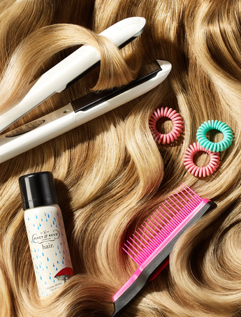 hair care products featuring tnagle teezer photographed on a wavy hair texture as an editorial for LOOK magazine By Ian Oliver Walsh Still Life Photographer London